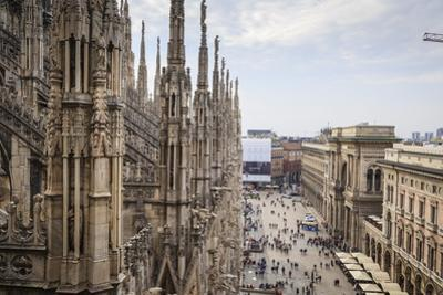 View over the Piaza Duomo from the Duomo (Cathedral), Milan, Lombardy, Italy, Europe by Yadid Levy