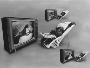 An Ape Participating in a Study of Ape Addiction to Tv by Yale Joel