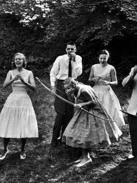 Archery Providing Entertainment at a Teenage Party by Yale Joel