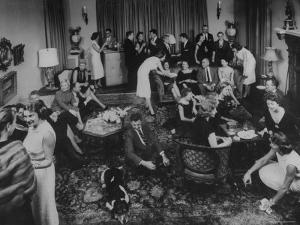 Cocktail Party in the Home of Mrs. R. Craig Montgomery by Yale Joel