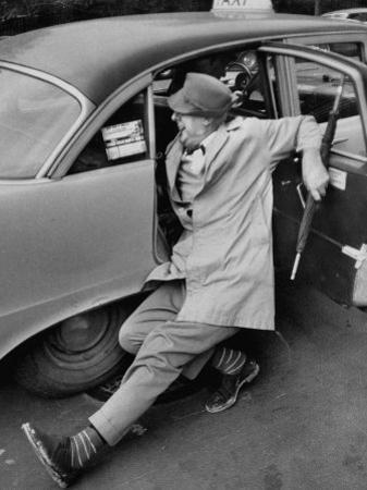 French Actor Jacques Tati Comically Getting Out of a Cab by Yale Joel