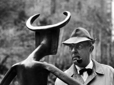 French Actor Jacques Tati Looking at a Sculpture by Yale Joel