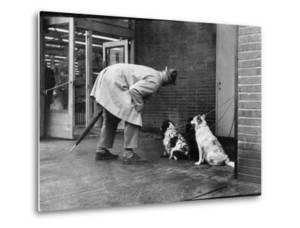 French Actor Jacques Tati Talking to a Couple of Dogs by Yale Joel