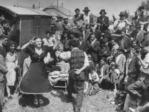 French Gypsies Playing Music and Dancing by Yale Joel