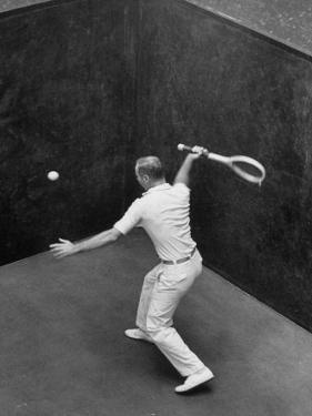 Player Playing Squash at a Local Club by Yale Joel