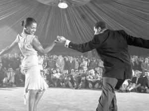 Professional Dancers Performing the Mambo by Yale Joel