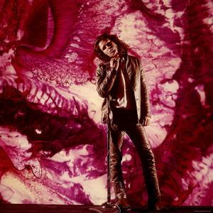 Rock Star Jim Morrison of the Doors Standing Alone in Front of a Purple Psychedelic Backdrop by Yale Joel
