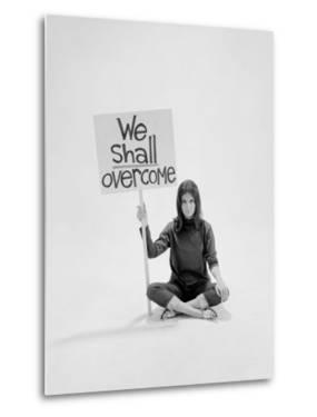 "Writer Gloria Steinem Sitting on Floor with Sign ""We Shall Overcome"" Regarding Pop Culture by Yale Joel"