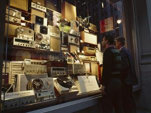Young Men Men Look at a Window Display of Stereo and Recording Equipment, New York, NY, 1963 by Yale Joel