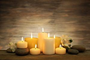 Beautiful Composition with Candles and Spa Stones on Wooden Background by Yastremska