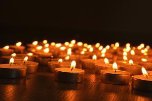 Burning Candles on Dark Background by Yastremska