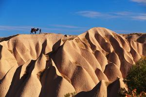 Camel and the Cameleer on the Rock and Tuff Formations of Cappadocia Which Creates Very Nice Patter by Yavuz Sariyildiz