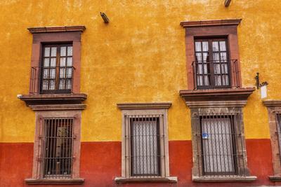 https://imgc.allpostersimages.com/img/posters/yellow-red-wall-brown-windows-metal-gates-san-miguel-de-allende-mexico_u-L-Q1D0AK80.jpg?p=0