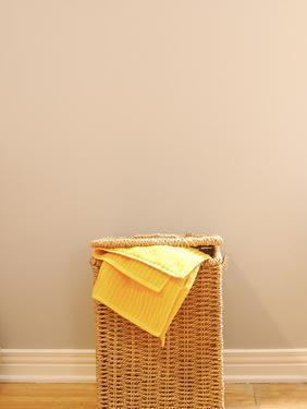 Yellow Towel in Wicker Laundry Basket