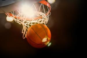 Basketball Going through the Basket at a Sports Arena (Intentional Spotlight) by yobro