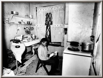 Young African American Studies By Kitchen Stove Because His Apartment Is Without Heat Photo Allposters Com