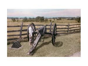 Young Boy Observes the Piece of Artillery at Gettysburg Battlefield