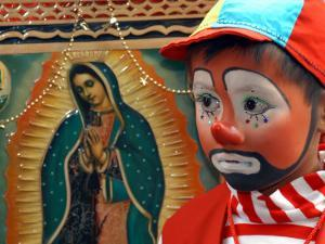 "Young Clown, ""Bolillito,"" Stands Next to an Image of the Virgin of Guadalupe in Mexico City"