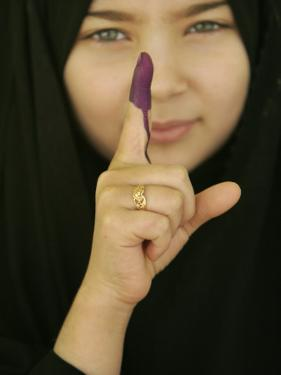 Young Girl Shows Her Inked Finger, Even Though She Was Too Young to Vote, in Karbala, Iraq