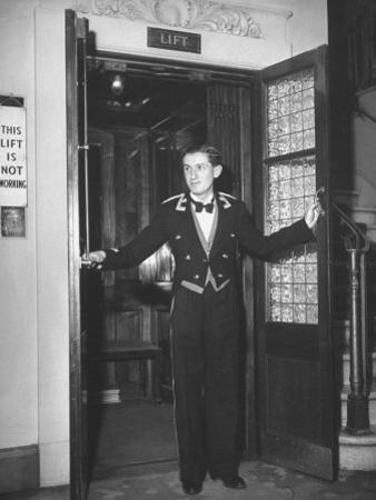 "Young Man Blocking the Entrance to the ""Lift"", in America it Is Called an Elevator"