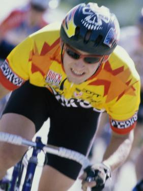 Young Man Cycling in a Race