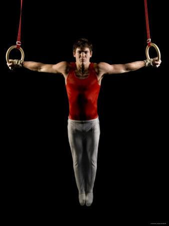 Young Man Exercising on Gymnastic Rings, Bainbridge Island, Washington State, USA