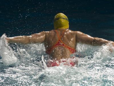 Young Woman Swimming the Butterfly Stroke in a Swimming Pool, Bainbridge Island, Washington, USA
