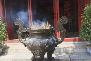 Hanoi, Vietnam. Incense offering at Ngoc Son Pagoda, a Buddhist temple by Yvette Cardozo