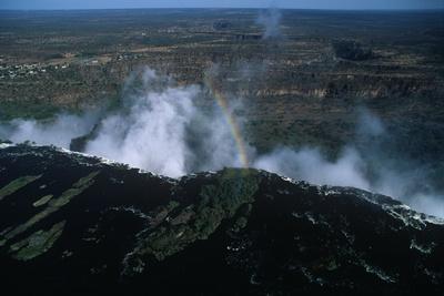 https://imgc.allpostersimages.com/img/posters/zambia-mosi-oa-tunya-national-park-rainbow-over-victoria-falls_u-L-PRLG6E0.jpg?p=0