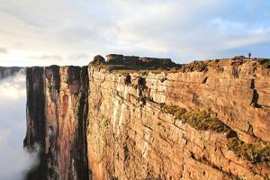 Sheer Cliffs of Mount Roraima - Landscape with Clouds Background by zanskar