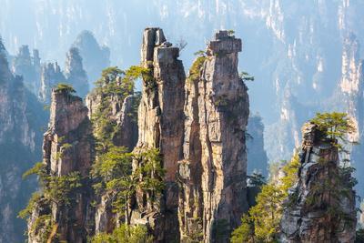 https://imgc.allpostersimages.com/img/posters/zhangjiajie-national-forest-park-at-wulingyuan-hunan-china_u-L-Q103EP30.jpg?p=0