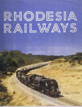 Zimbabwe : a Massive Steam Locomotive Hauls a Long Train across Rhodesia's Wide Open Spaces