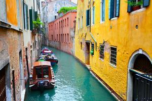 Narrow Canal with Boats in Venice, Italy by Zoom-zoom