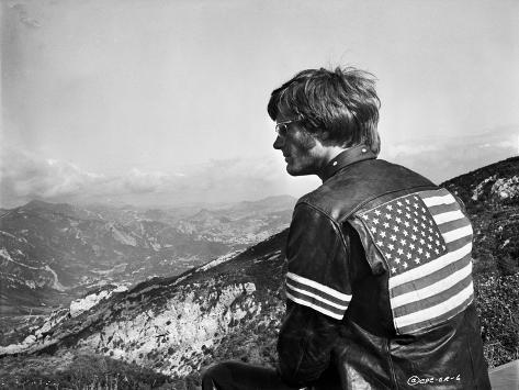 Easy Rider Seated in American Flag Jacket Photographie