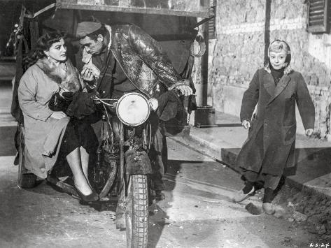 La Strada as Zampano Riding Bike Movie Scene Photographie