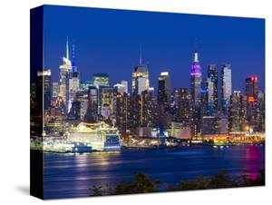 USA, New York, Manhattan, Midtown Skyline with the Empitre State Building across the Hudson River by Alan Copson