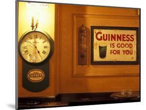 Guinness sign in pub, Dublin, Ireland by Alan Klehr