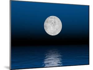 Beautiful Full Moon Against a Deep Blue Sky over the Ocean