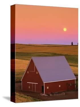Sun Setting Behind Barn by Darrell Gulin