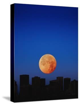 Orange Moon in Dark Sky by Design Pics/Kelly Redinger