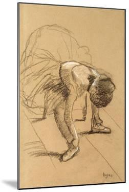 Seated Dancer Adiusting Her Shoes, C1876 by Edgar Degas