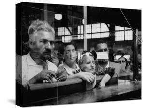 Here Waiting Faces Mirror Anxiety as They Hear List of the Survivors of Sinking Ship Andrea Doria by Gordon Parks