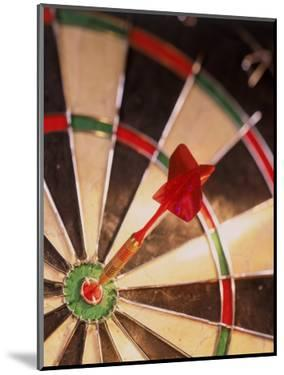 Dart in Bull's Eye of Dart Board by Greg Smith