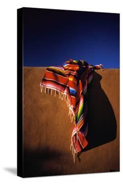 Southwest Blanket on Adobe Wall by Jim Zuckerman