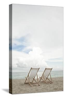 Two Empty Chairs on the Beach. by MoMo Productions
