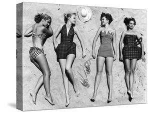 Models Sunbathing, Wearing Latest Beach Fashions by Nina Leen