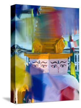 Buddhist Stupa Viewed Through Prayer Flags at Night, Kathmandu, Nepal by Philip Kramer
