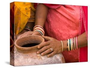 Woman's Hands on a Pottery Jug for Carrying Water, Thar Desert, Jaisalmer, Rajasthan, India by Philip Kramer