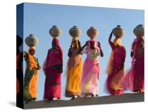 Women Carrying Pottery Jugs of Water, Thar Desert, Jaisalmer, Rajasthan, India by Philip Kramer