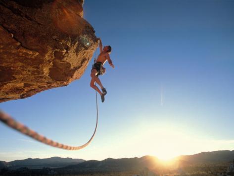 Rock Climber Dangling Off of Cliff Fotografisk trykk